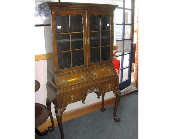 A 1930's walnut diplay cabinet,