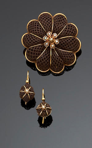 A suite of Victorian hair jewellery comprising a brooch and earrings
