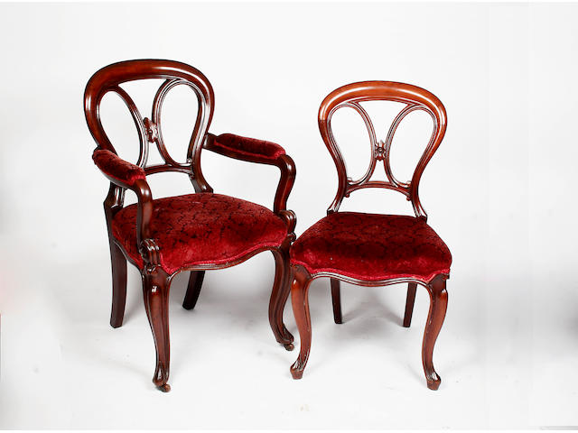 A set of eight Victorian mahogany balloon back dining chairs