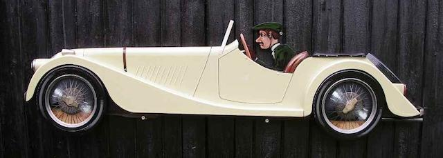 A hand painted wooden profile of a Morgan sports car,