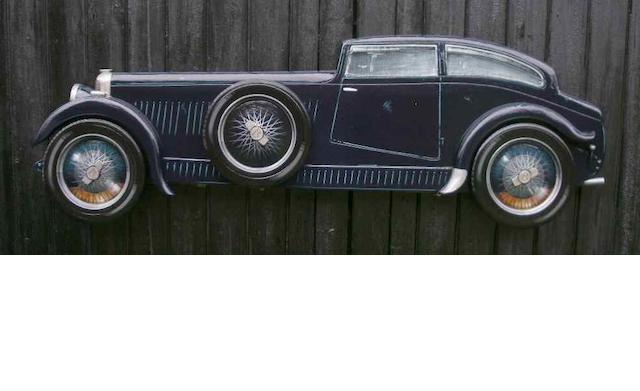A hand painted wooden profile of the Woolf Barnato blue train Bentley,