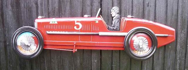 A hand painted wooden profile of an Alfa Romeo P2