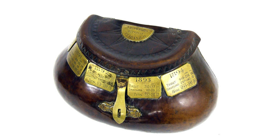 A fine 19th century heavily stitched leather pot bellied creel with belt loop and white painted interior