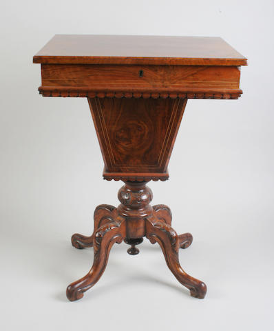 A Victorian burr walnut sewing table