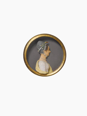 J.H. Hagbolt (German 1775-1849): An early 19th century coloured wax miniature of a young lady