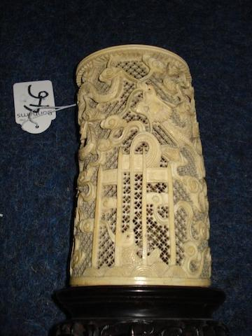 An ivory tusk vase of reticulated form;