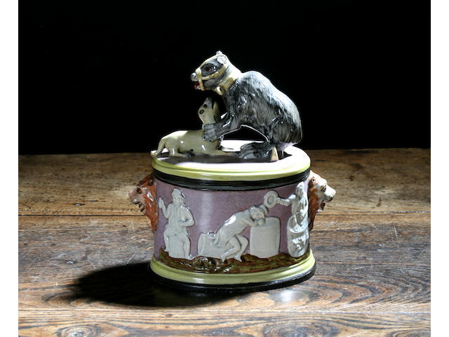 A good pearlware 'bear baiting' tobacco box and cover