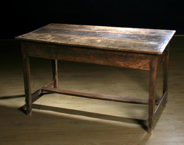 An 18th Century oak, elm and fruitwood farmhouse table