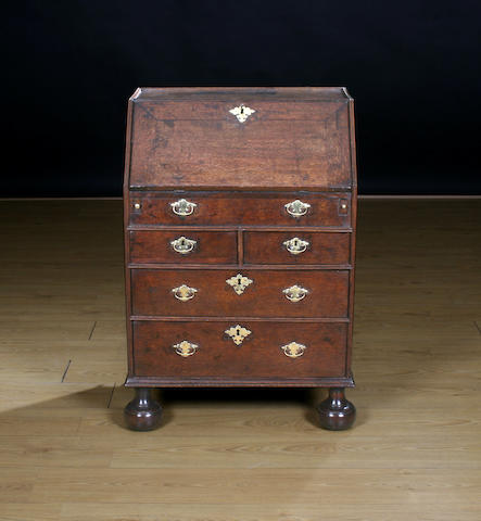 An early 18th Century oak bureau