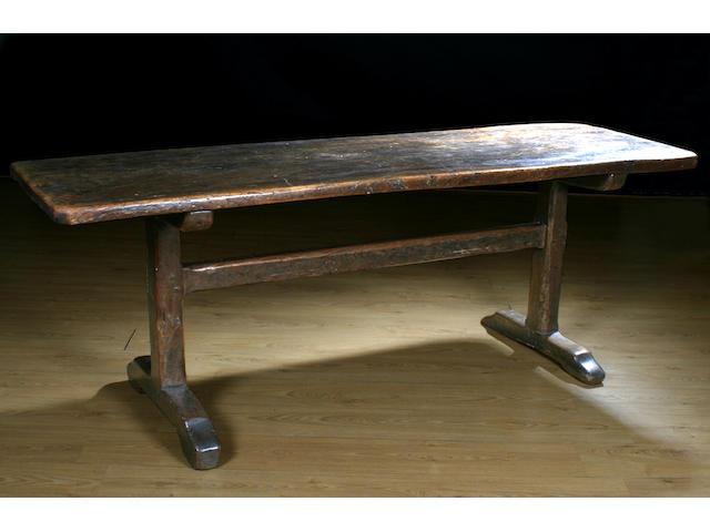 A late 18th Century elm trestle table