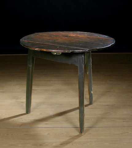 An early 19th Century oak cricket table
