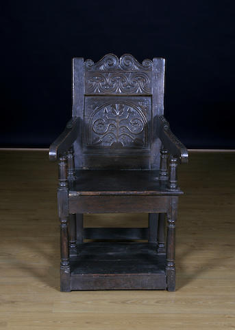 A 17th Century and later oak open armchair