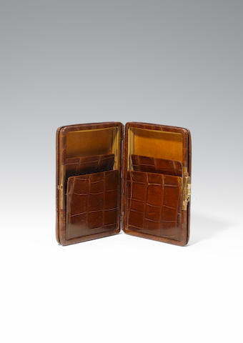 A travelling crocodile cigar case, unmarked,