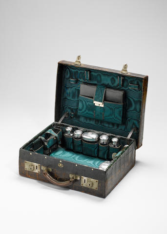 An Edwardian green crocodile leather 14 inch suitcase,  by Drew & Sons, the silver mounts by Samuel