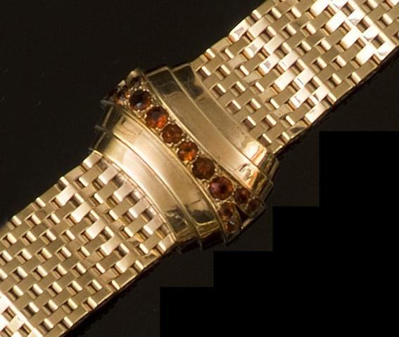 A gold and garnet cocktail bracelet,