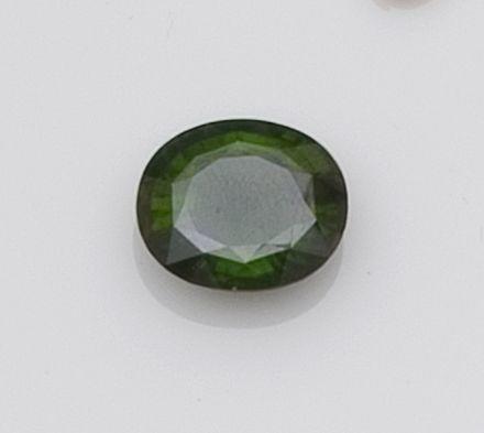 An unmounted green sapphire
