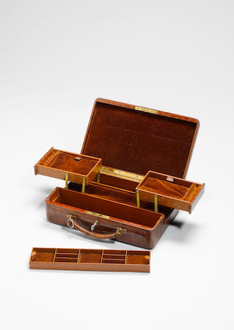 An early 20th century mid brown crocodile leather travelling jewellery case, by Finnigans,