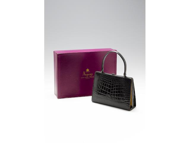A black crocodile lady's handbag,purchased from Asprey,