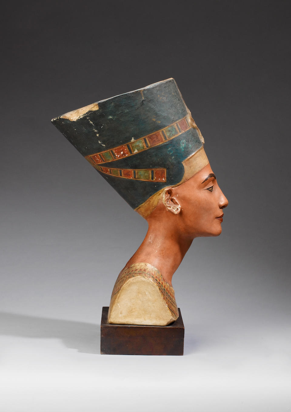 An Egyptian Amarna style plaster bust of Nefertiti