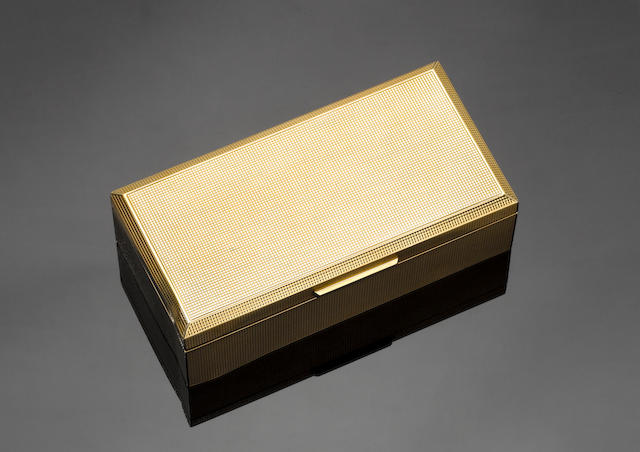 A 9 carat gold cigarette box, incuse stamped 'Dunhill, London', London 1958,