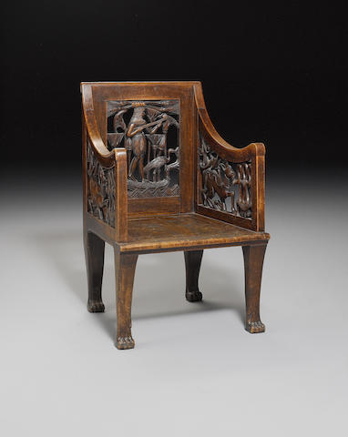 An Egyptian Revival wooden openwork chair