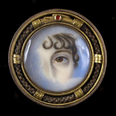 An early 19th century gold mounted 'eye' brooch