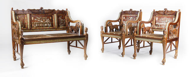 An oak and inlaid Egyptian Revival suite Circa 1920