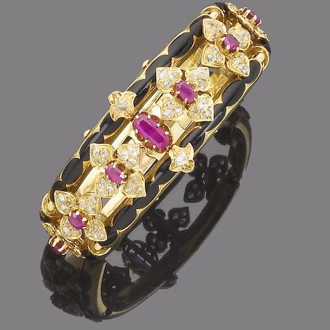 A late 19th century ruby, diamond and enamel bangle