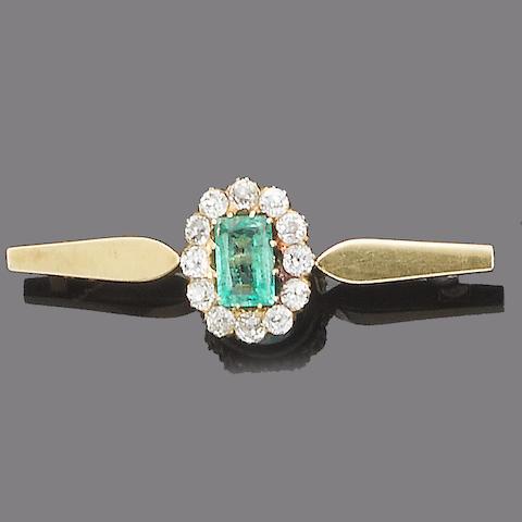An emerald and diamond bar brooch