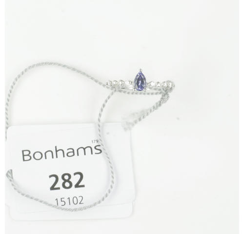An 18ct white gold diamond and tanzanite ring,