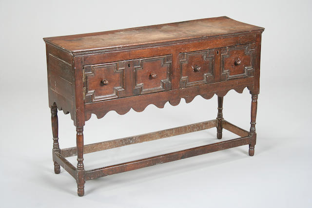An early 18th century and later oak dresser