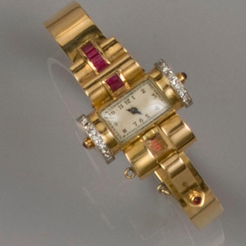 A lady's gem set bangle cocktail watch, circa 1940's