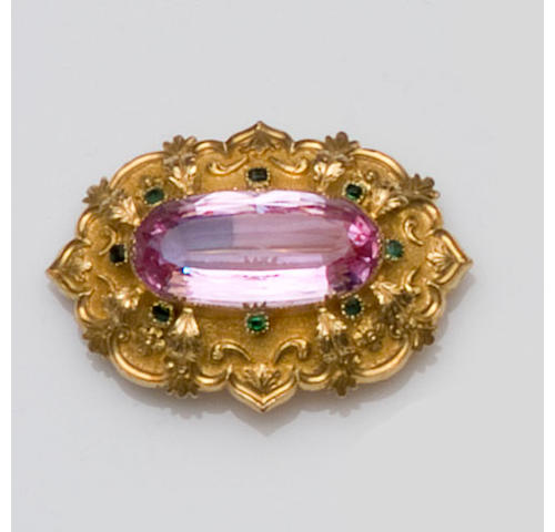 An early Victorian pink topaz and emerald brooch