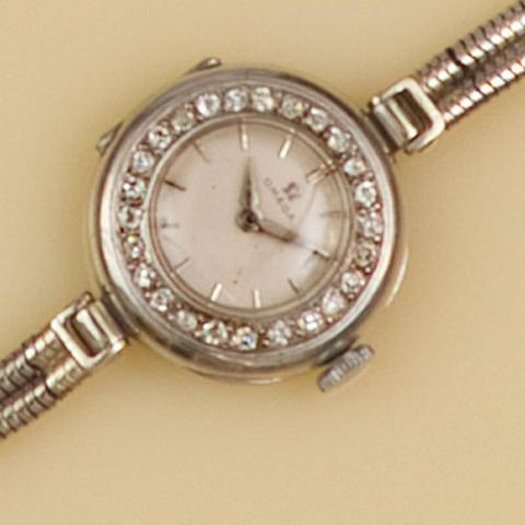Omega: A lady's diamond set wristwatch