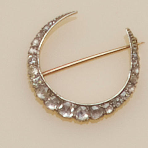 A diamond crescent brooch