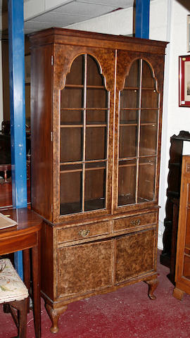 An early 20th century walnut display cabinet