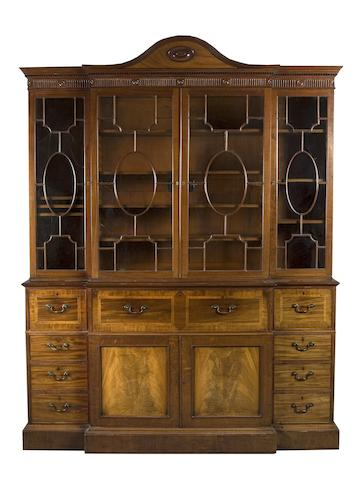A fine George III mahogany and inlaid breakfront bookcase in the style of Gillow, presented by His Majesty George III to his lawyer Peter Still