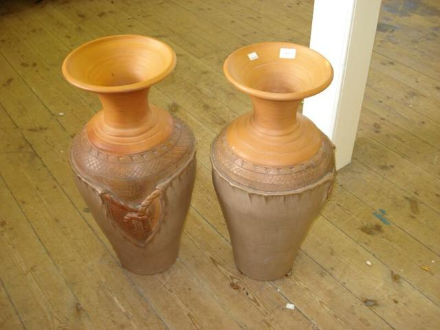 A pair of large terracotta vases