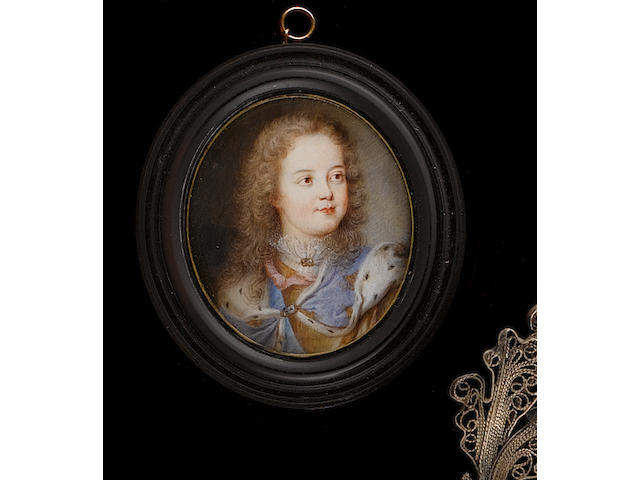 (n/a) French School, circa 1715 Louis XV (1710-1774) as a child, wearing blue ermine-lined cloak embroidered with gold fleur-de-lys over white lace collar, his hair worn long and curling