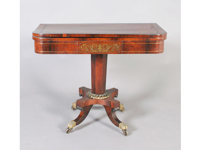 A Regency rosewood and brass line inlaid pedestal card table
