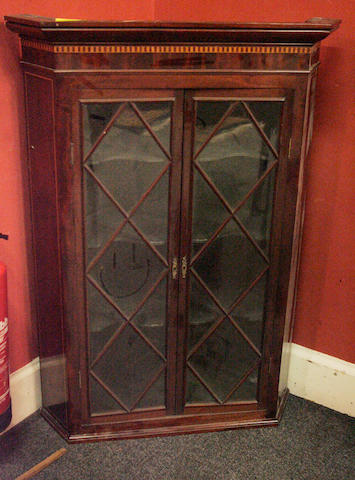 An inlayed Victorian mahogany corner cabinet