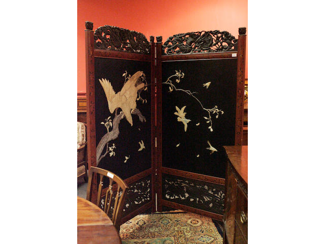 A Japanese two-fold black lacquer and ivory floor screen 19th century