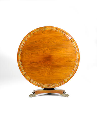 A rosewood and brass-inlaid breakfast table 135cm wide x 136cm deep x 74cm high