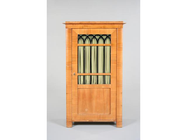A Biedermeier style birch cabinet,