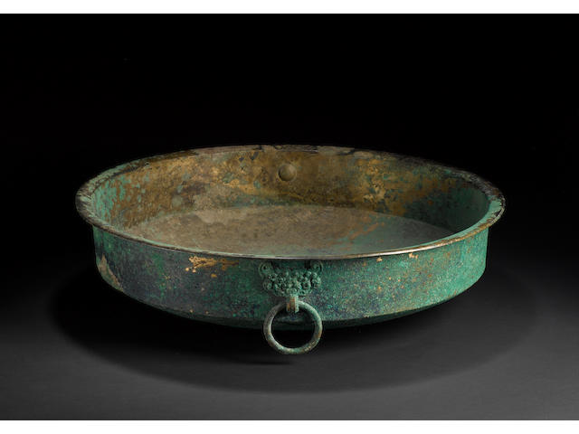 A large bronze basin of cylindrical form with taotie mask and loose-ring handles Han Dynasty