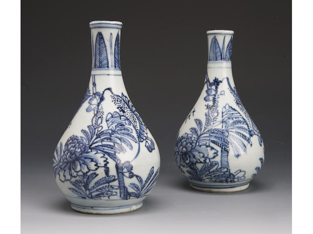 A pair of blue and white bottle vases late Ming