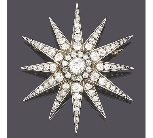 A late 19th century diamond star brooch/pendant,