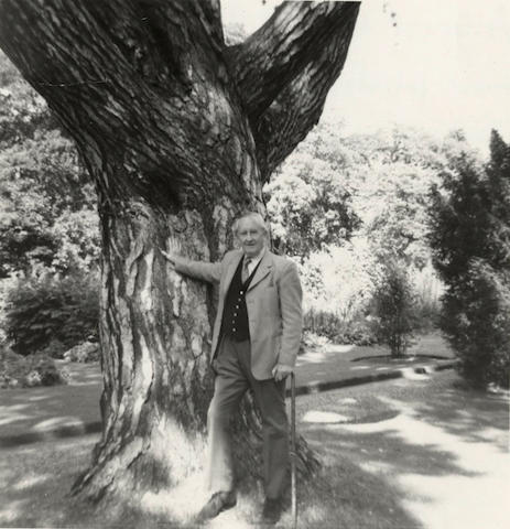 TOLKIEN (J.R.R.) Photograph of the author, leaning against a tree