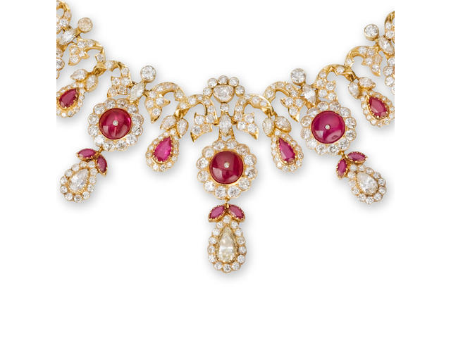 A ruby and diamond necklace, brooch and pair of earrings