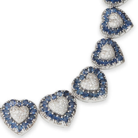 A sapphire and diamond necklace, bracelet, earring and ring suite (4)